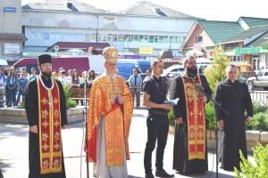 священики